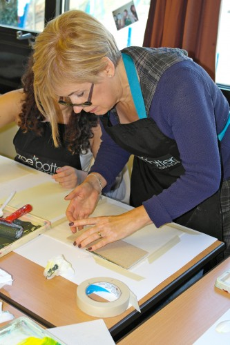 'printing with hand made blocks on to cotton calico fabric'