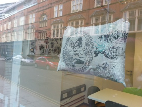 'busy print cushion in a busy street!'