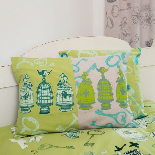 'Lime bird cage and the key' screen printed cushion